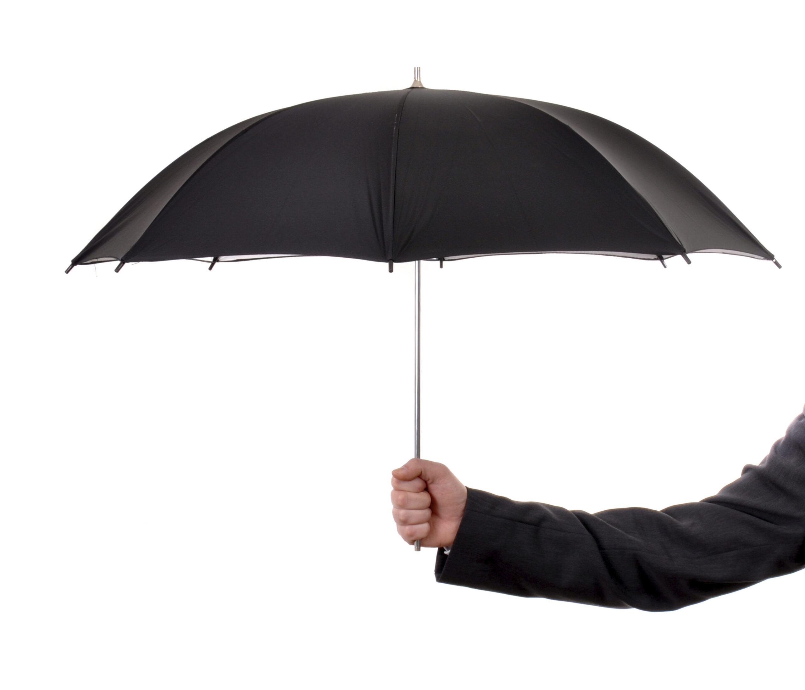 Arm holding a black umbrella