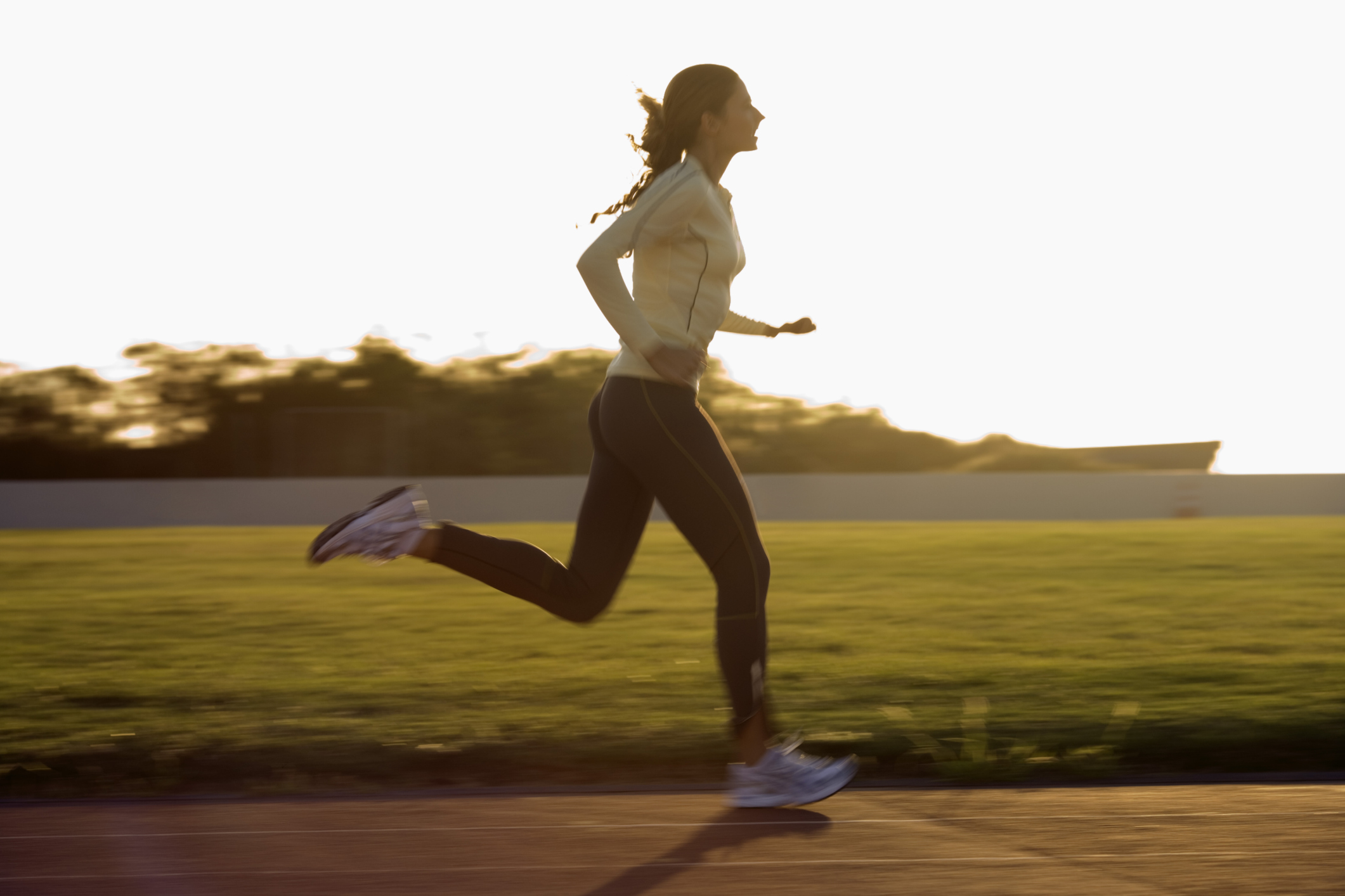 Woman running on an outdoor track