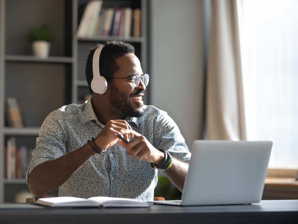 man working from home office with headphones