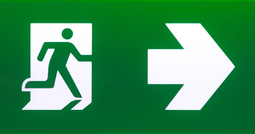 Green person with arrow sign