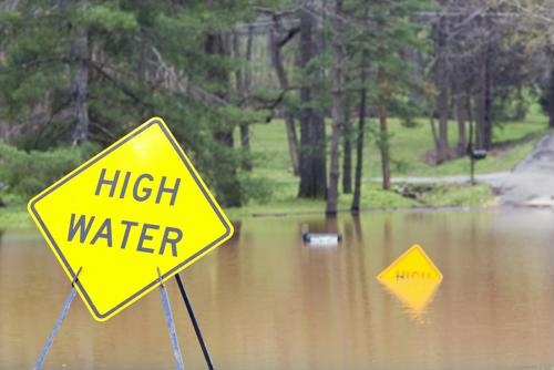 Heed all warning signs when flooding complicates travel.