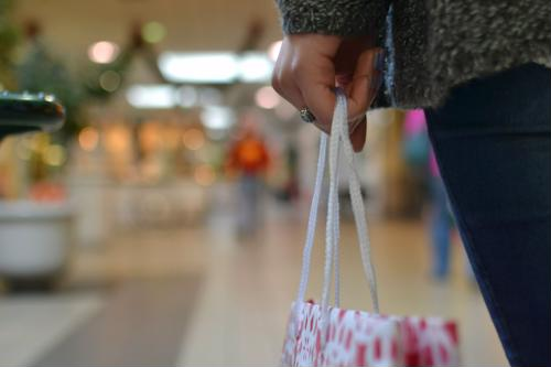 Keep your shopping bags to a minimum while you're in stores to avoid theft.