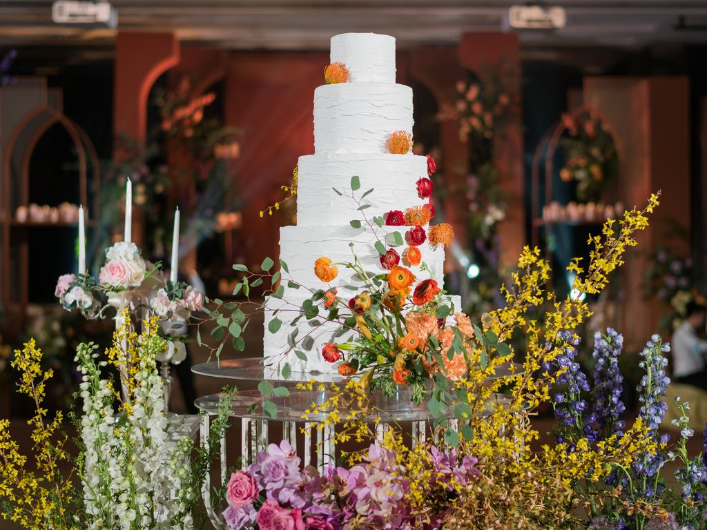 wedding cake behind some flowers