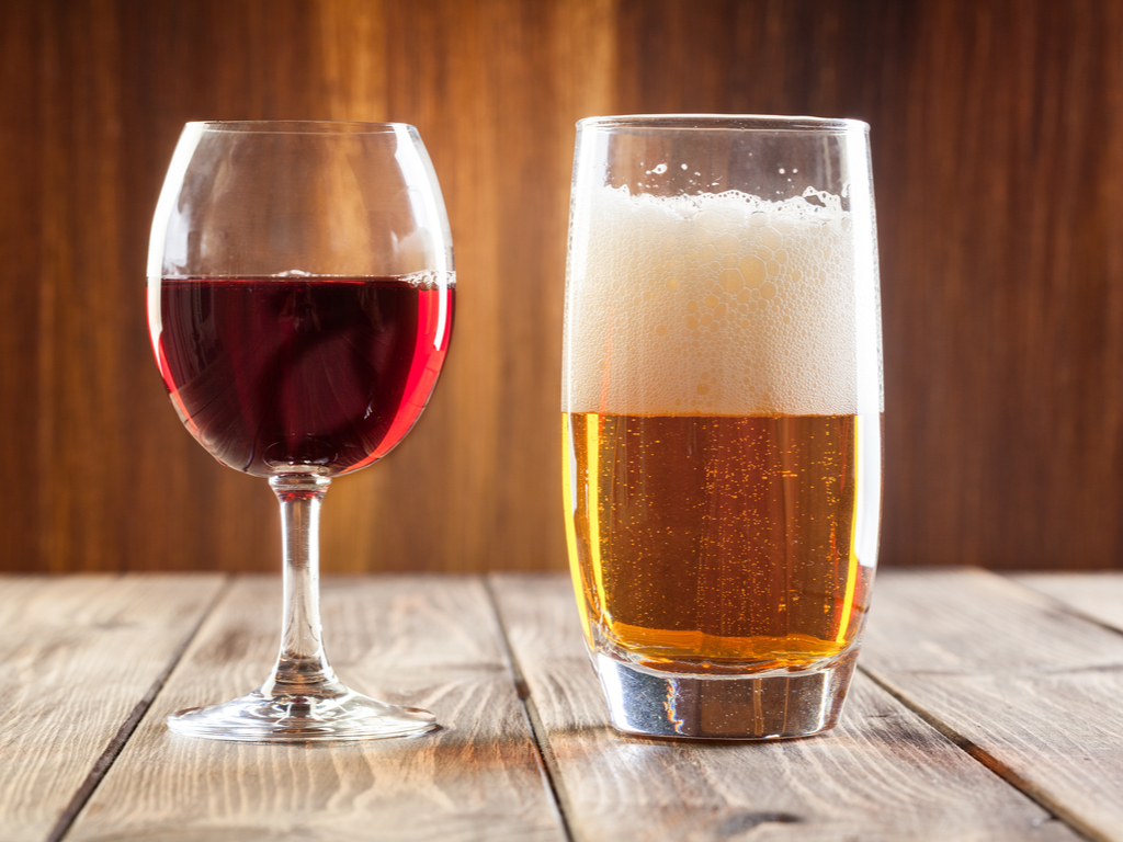 red wine glass and beer glass on a table