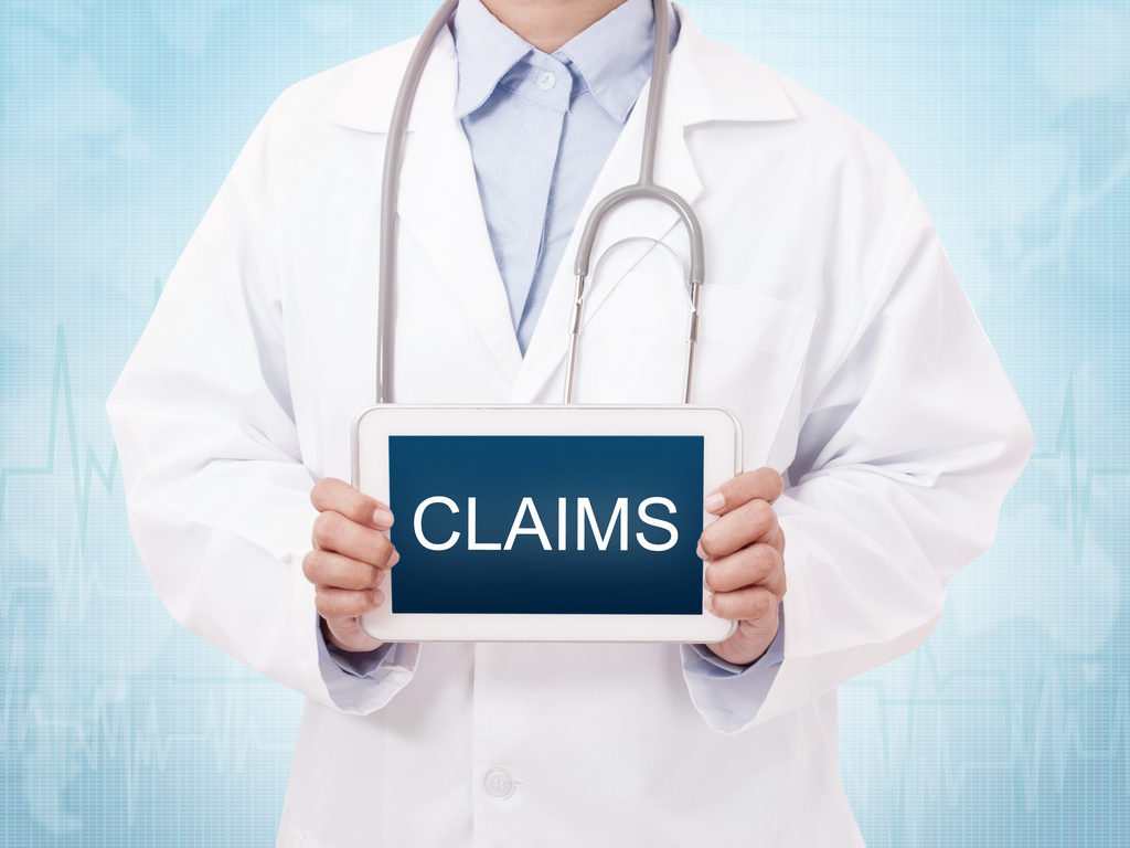 "doctor holding a sign that says ""claims"""