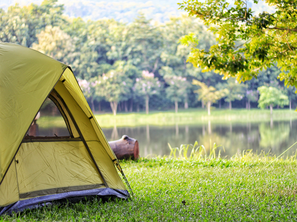 Camping tent next to a lake