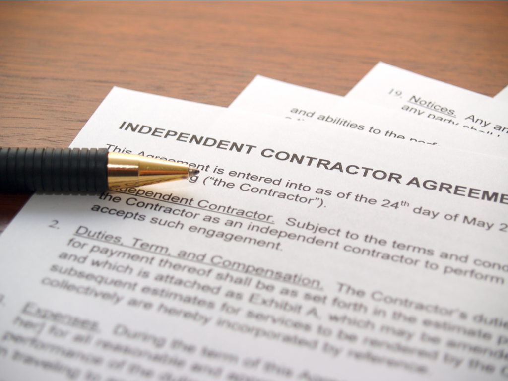 independent contractor forms with a pen